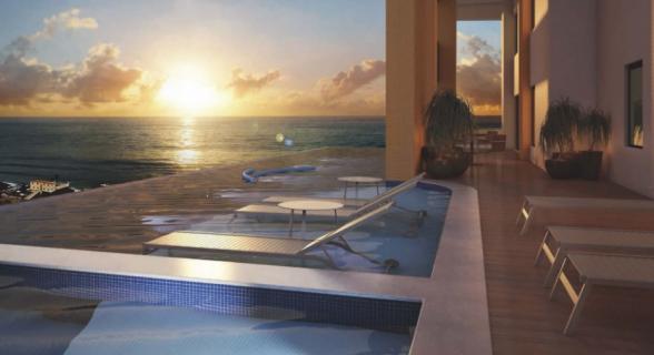 Vista da piscina privativa da cobertura do La Vue, a mais de 100 metros de altura, para a Baía de Todos-os-Santos